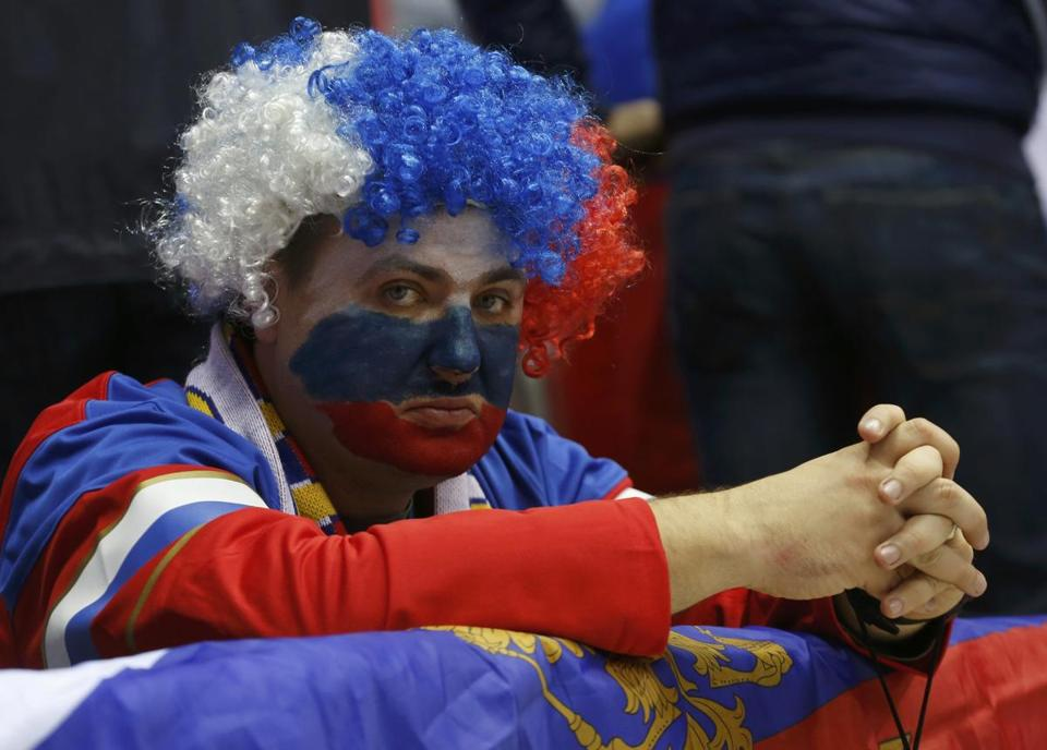 Sporting the colors of the Motherland, this sad-faced fan sported the face of Russia after its hockey team was eliminated.